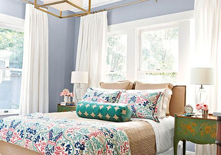 Patterned throw pillows on neutral bedding inspiring spaces pinterest guest rooms love - Spots of color in the bedroom linens and throws ...
