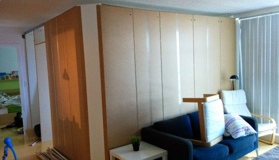 A temporary removable wall creates an extra bedroom from for Temporary bedroom walls