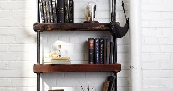 Combine reclaimed wood and galvanized black pipe to create a rugged bookshelf that adds texture and warmth to any room. | See more about Bookshelves, Rustic Bookshelf and Rustic Industrial.