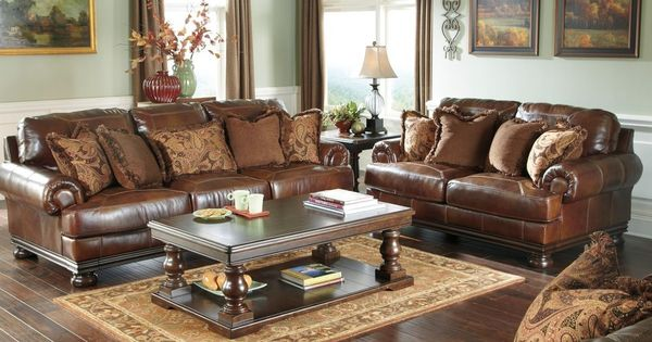 ashley genuine top grain leather brown sofa loveseat chair and a