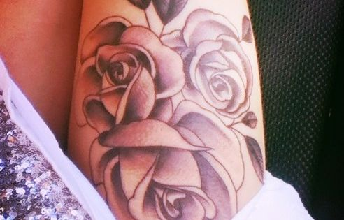 Flowers tattoo thigh
