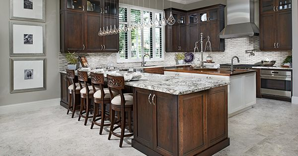 This Lavish Kitchen In Boca Raton Fl Boasts Modern Pendant Lighting A Sleek Metal Range Hood