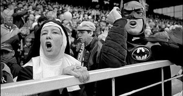 Bolton Football fans in costume (a nun and Batman) cheer for their