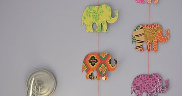 DIY Elephant hanging cutouts. Find a stencil online and trace it onto