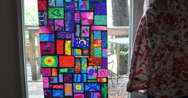 Sharpie marker on wax paper makes stained glass windows! Just hold it