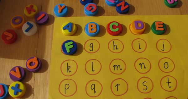 Alphabet Match using recycled bottle caps and foam stickers