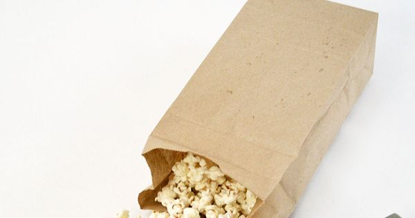 Microwave Popcorn Trick Add 1/3 cup popcorn kernels to a brown paper