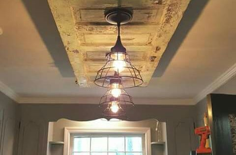 Old Door On The Ceiling With Two Hanging Lights Great