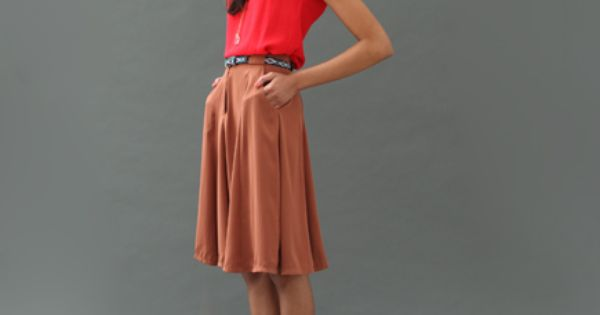 loose top and a flowy skirt with a statement belt.