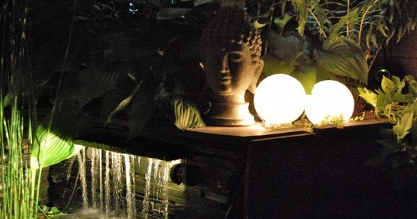 Easy glowing orbs for the garden! Glass shades plus christmas lights =