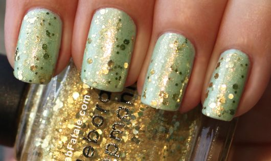 Gold sequin glitter nail polish on top of mint green