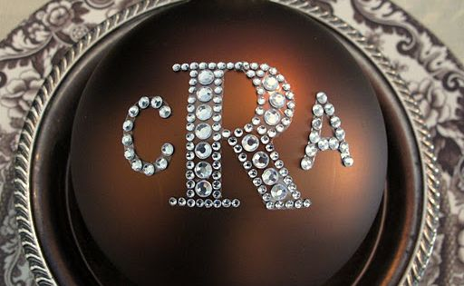 Hobby Lobby sticker monogram letters placed on ornaments. Cute way to make