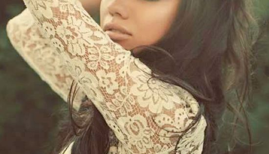 Long hair and white lace shirt.