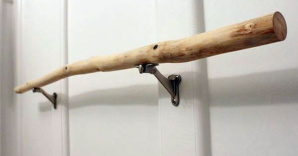 Unique bathroom storage DIYs and inspirations. I like this branch as a