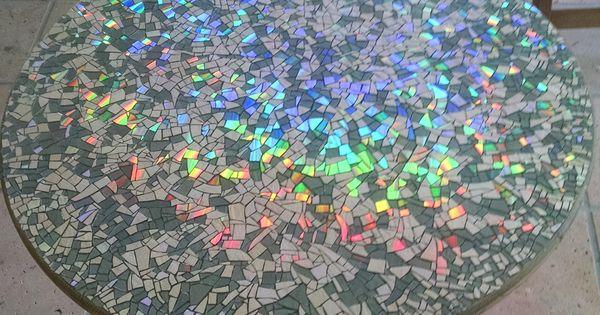 I made a mosaic tabletop using broken cds finishing it for Raumgestaltung yin yang
