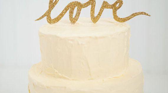 {gold glitter LOVE script wedding cake topper | emilysteffen at Etsy |