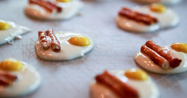 Bacon and eggs = Melted white chocolate, yellow M's, and pretzel sticks.