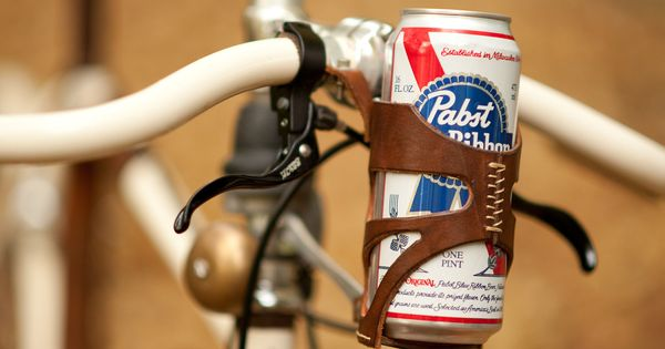 beer can holder for a bicycle? yes please!....my husband would go bike