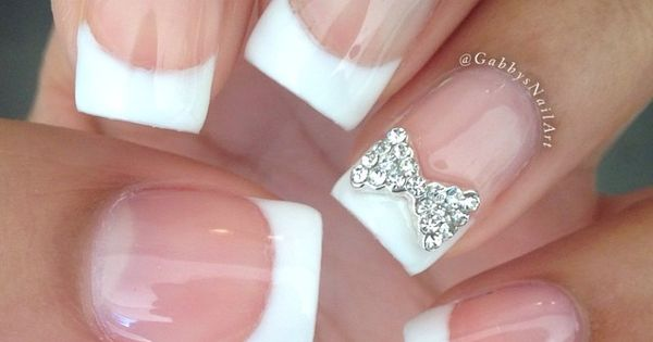 Cute and simple french tip with a bow done by @GabbysNailArt on