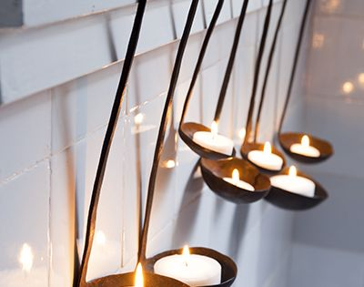 Spoons as tea light holders. Would be beautiful in the bathroom on