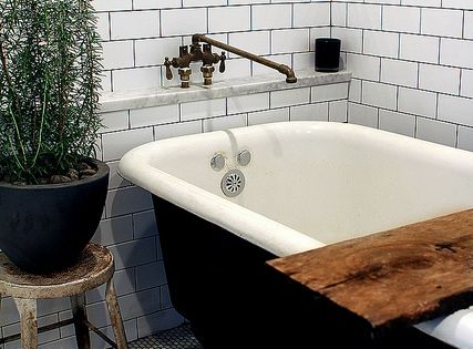 love the clawfoot tub with the reclaimed wood beam & the rusted
