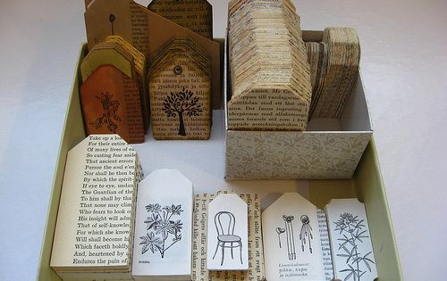 Make tags out of pages from an old book ... Pretty Paper,