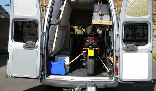 ford transit stealth camper with built in motorcycle. Black Bedroom Furniture Sets. Home Design Ideas