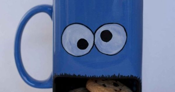 Cookie Monster coffee mug with opening at the bottom to hold cookies.
