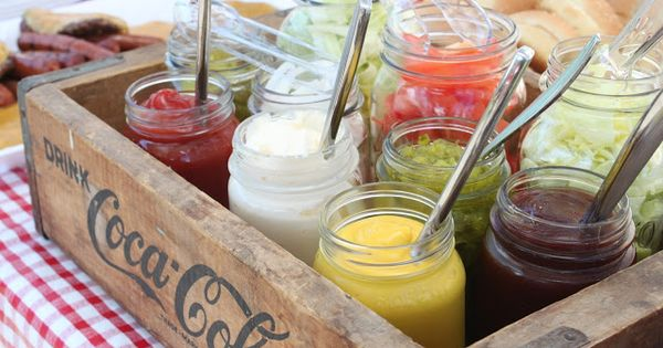 Put condiments and burger toppings in antique mason jars and then arrange