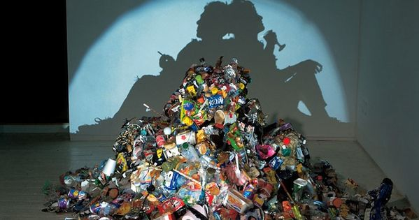 So bizarre! Piles of trash, but cast a shadow image of something