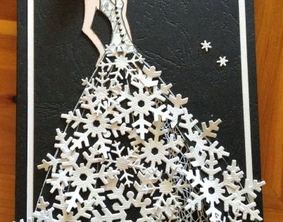 What a beautiful snowflake dress for a winter bride! Snowflake punches make