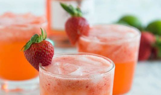 Strawberry margarita punch your favorite strawberry margarita all dressed up and turned into a for Green apple sangria olive garden recipe
