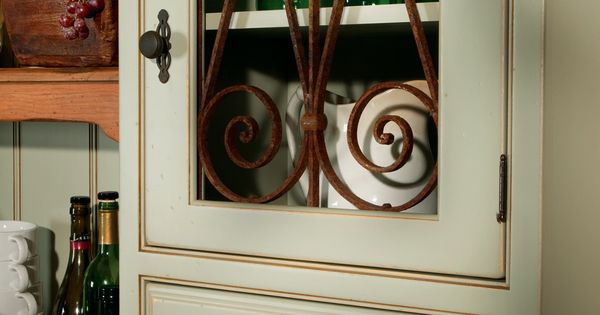 Unique vintage wrought iron panel inserts accentuate the - Wrought iron kitchen cabinet door inserts ...