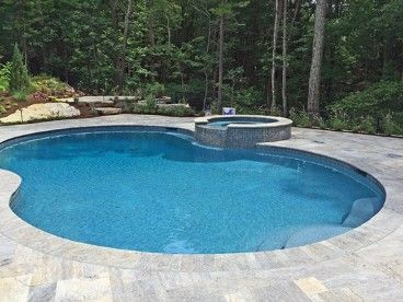 Kidney Shaped Pool With Tile Faced Spa And Travertine Deck By New View Kidney Shaped Pool Travertine Pool Decking Travertine Pool