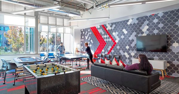 Comcast 39 s new office is red and white and hip all over for Hip office design