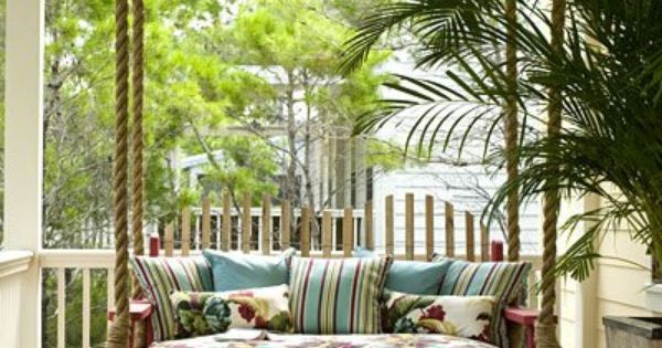 cute outdoor porch swing. i like the rope thats holding it. makes