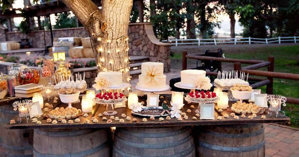table top held by several wooden wine barrels, country wedding idea or