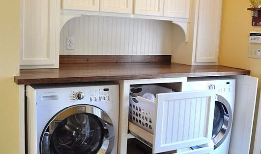 Front loading washer dryer set into a cabinet with doors for Arriere cuisine marciac