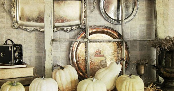 Exciting Fall Mantel Decor Ideas: Bookpage background, silver trays, an old window,