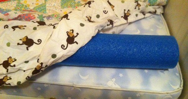 Use a swimming noodle, under a fitted sheet to keep a toddler