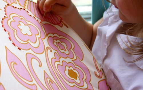 kids could pick from a choice of printed fabric squares and embroider