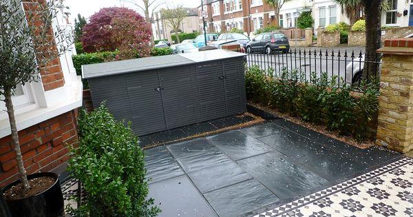 yellow brick london garden wall slate paving mosaic tile path metal rail