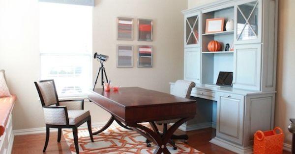 Orange wood tone on floor red wood tone on table against pale