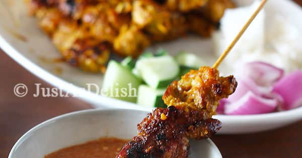Satay - grilled marinated skewered meat with spicy peanut sauce. The epitome