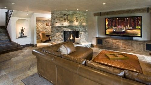 Amazing Basement Design - especially love the stone fireplace