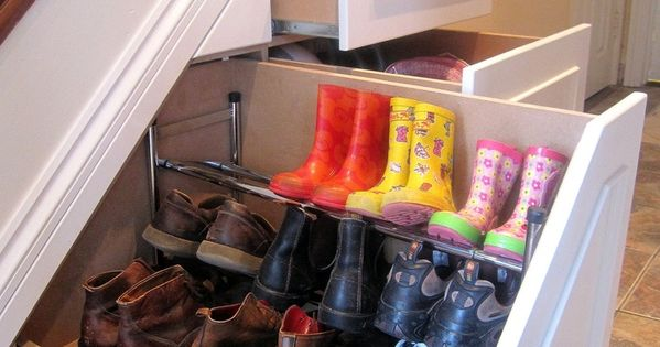 Awesome shoe storage idea! Build shoe racks in empty space under staircase