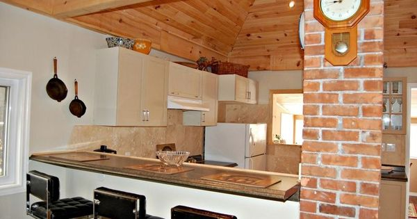 Love the exposed brick chimney in this st catharines home for Cabinex kitchen designs st catharines