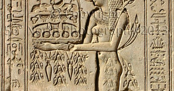 Ancient egyptian stone carving of a woman and harvest