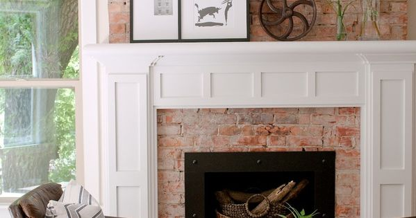 Toned Down Brick Fireplace Surround Extends Up The Wall