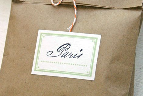 brown paper bag gift wrap with baker's twine and a sticker